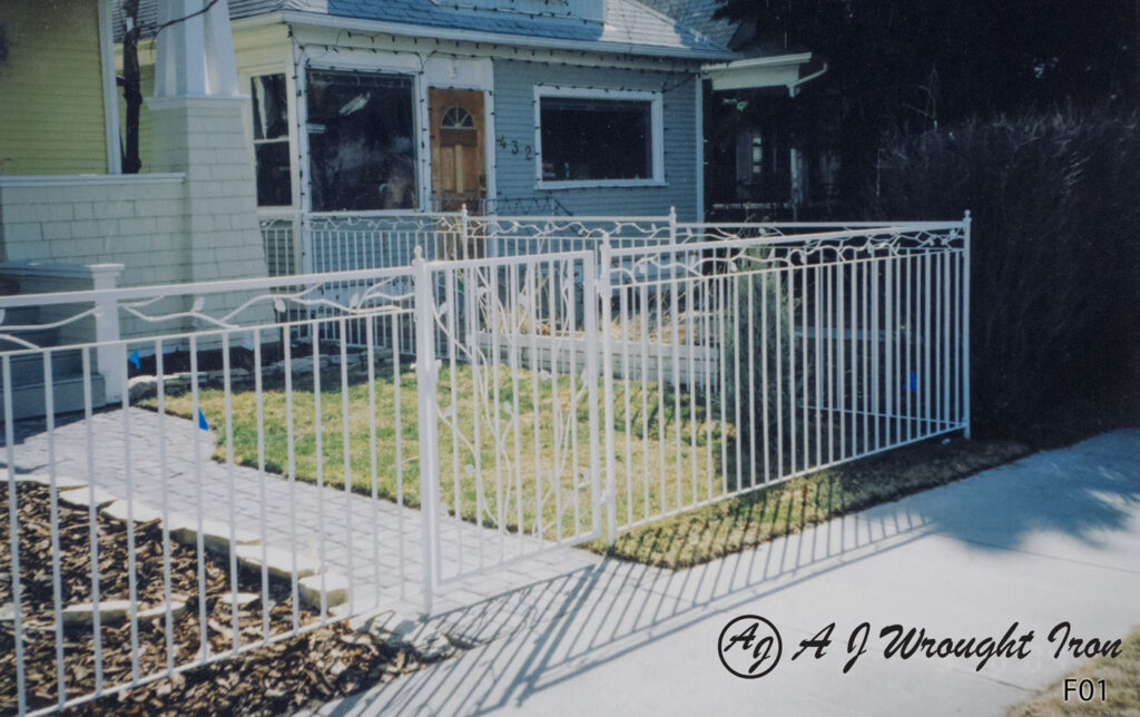 white leaf & vine iron fence with garden gate