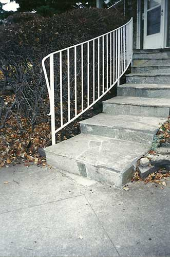 metal handrail - exterior curved stairs - white finish