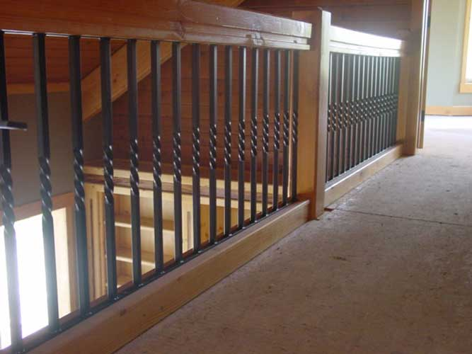 interior loft railing - wood with iron spindles