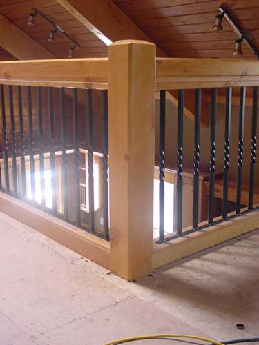 interior loft railing - wood posts with iron spindles
