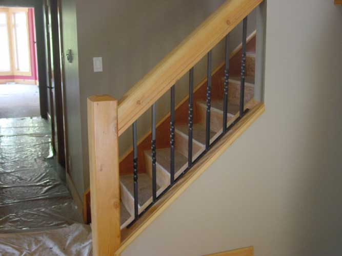 interior railing - wood posts with twisted iron spindles-