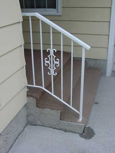 iron railing front house - white finish