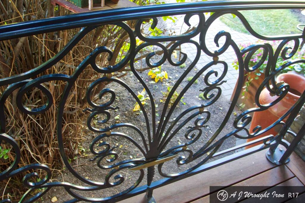 curved plant motif on metal railing