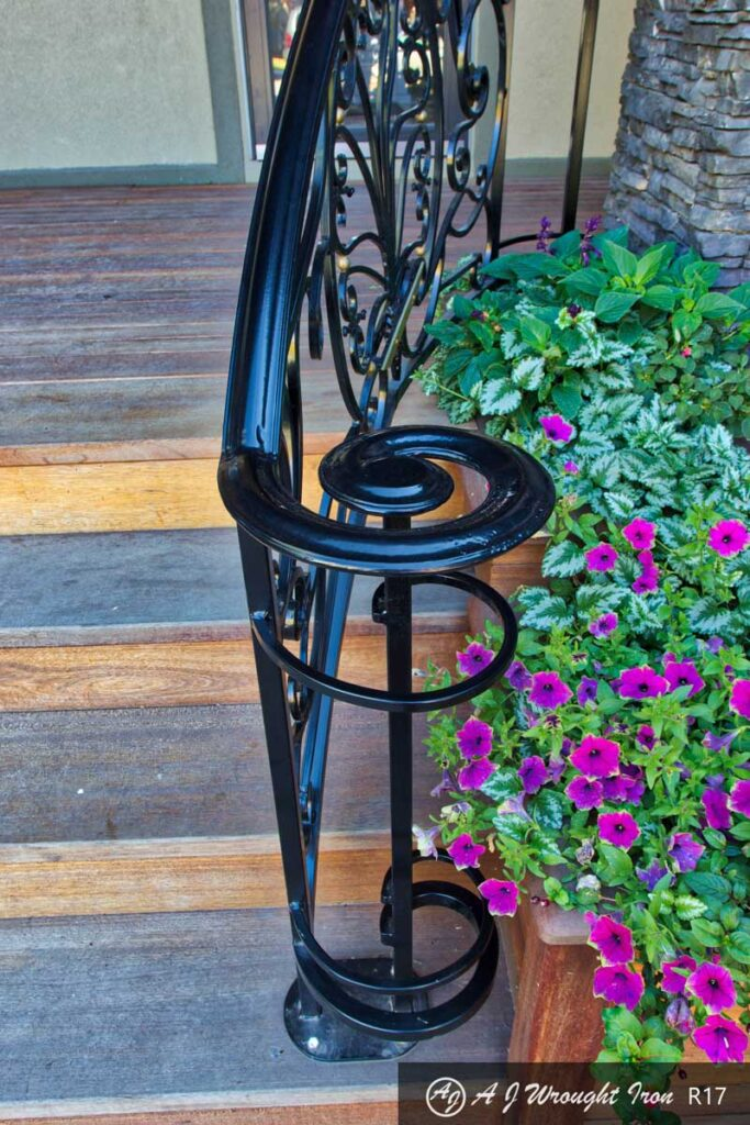 elegant exterior railing beside planter-curved end cap