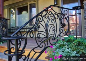 elegantly curved iron railing design Calgary