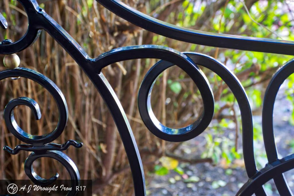 smooth curves of forged iron railing