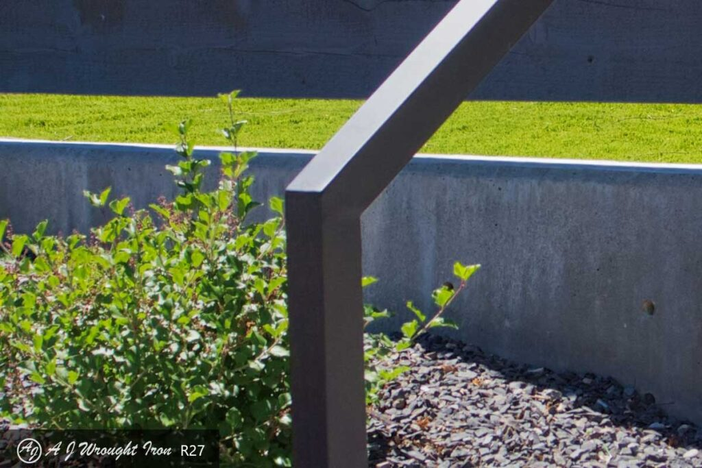 closeup of a minimalist exterior step railing