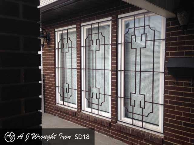 window security bars on brick house in Calgary - brown finish