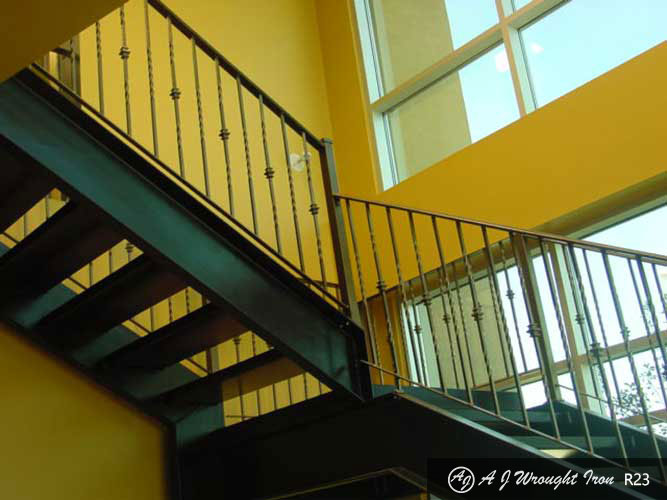 staircase railing with twisted iron spindles