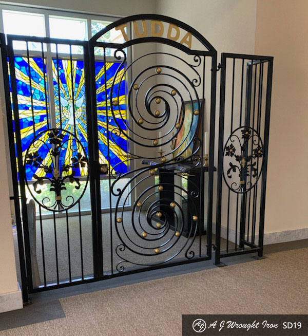 ornamental forged iron security door - curved forged iron