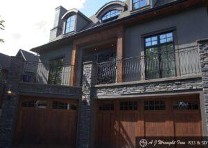 decorative deck railing above garage