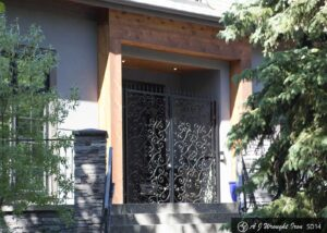 iron front doors on beautiful home