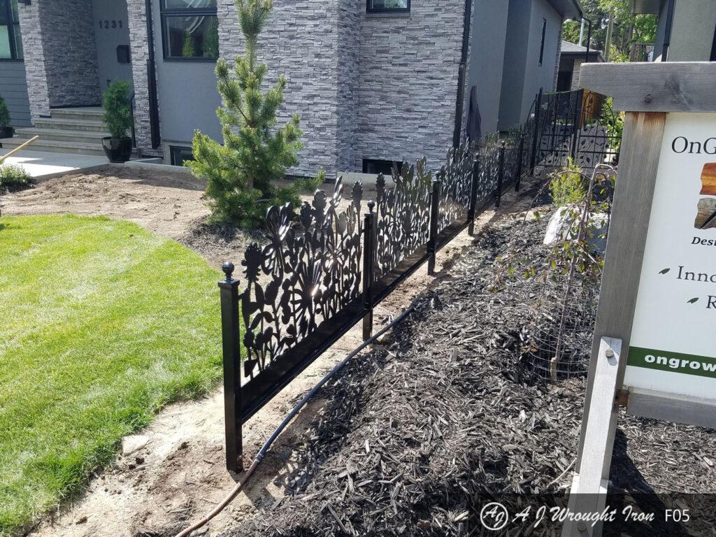 metal garden fence with laser cut flower design