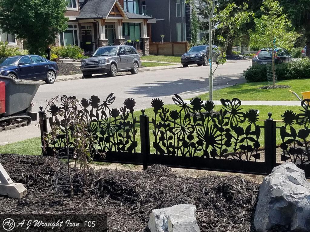 laser cut flower design in custom metal garden fence