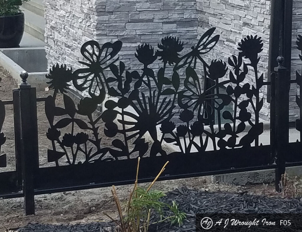 closeup of laser cut flowers in metal garden fence