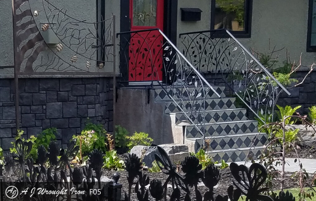 metal railing with leaf and branch motif