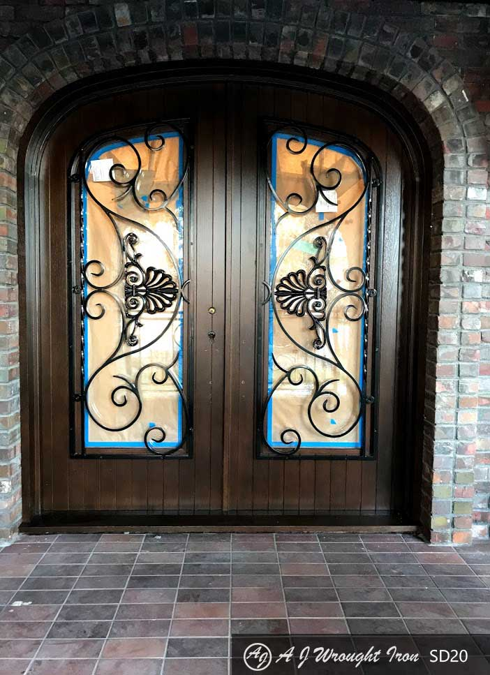 forged iron security grill on double doors