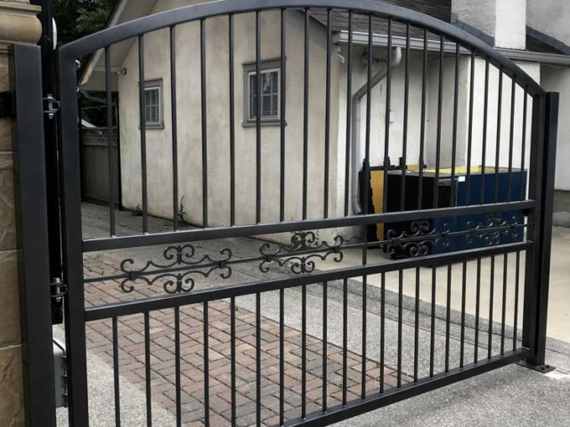 black iron security gate on residential driveway