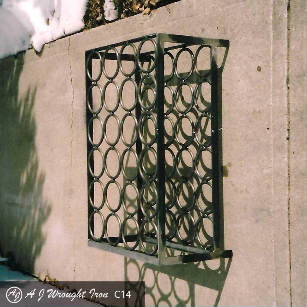 custom iron wine rack hanging on concrete wall