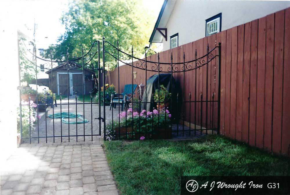 6' tall iron garden fence with wide gate