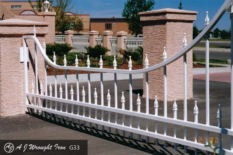 wrought iron driveway gate with pickets - white
