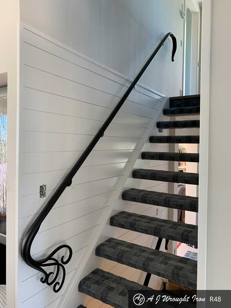 stair railing with forged curling metal design