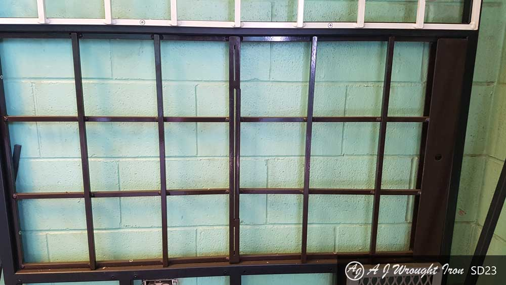 window bars - simple iron grid painted brown