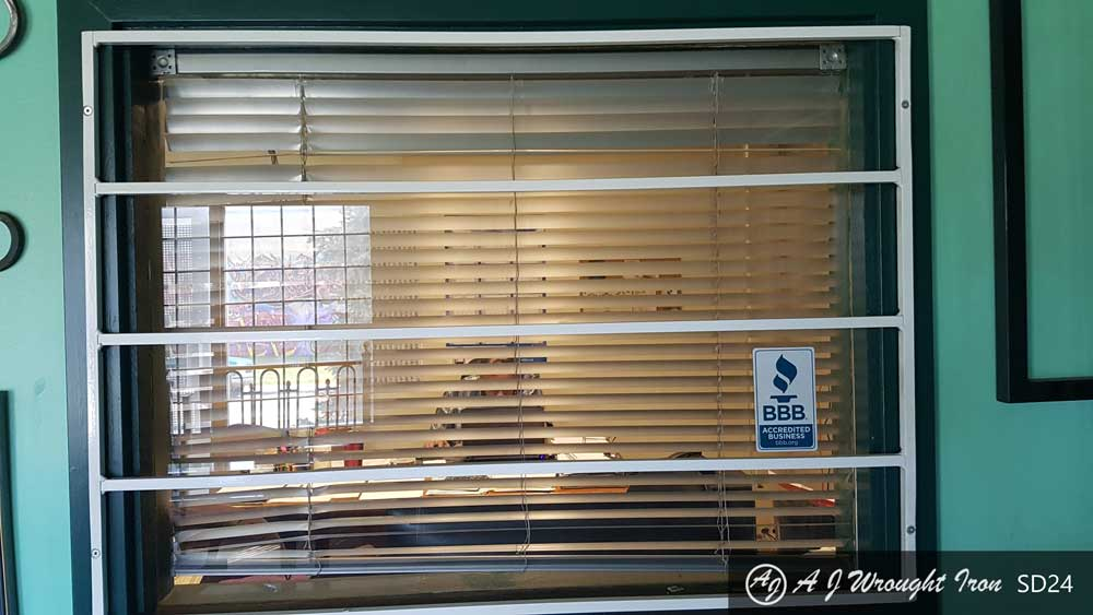 horizontal iron window grill - painted white