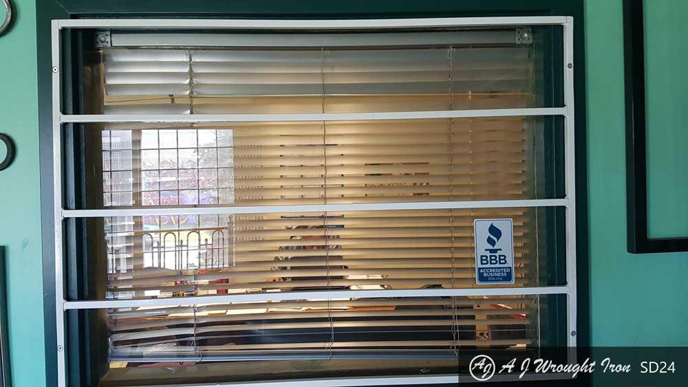 horizontal iron window grill - painted white