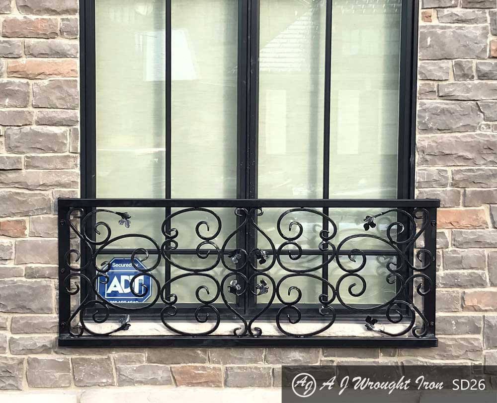 black wrought iron window grill - ornamental leaf and vine