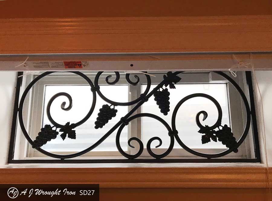 grape and vine window grill in basement window