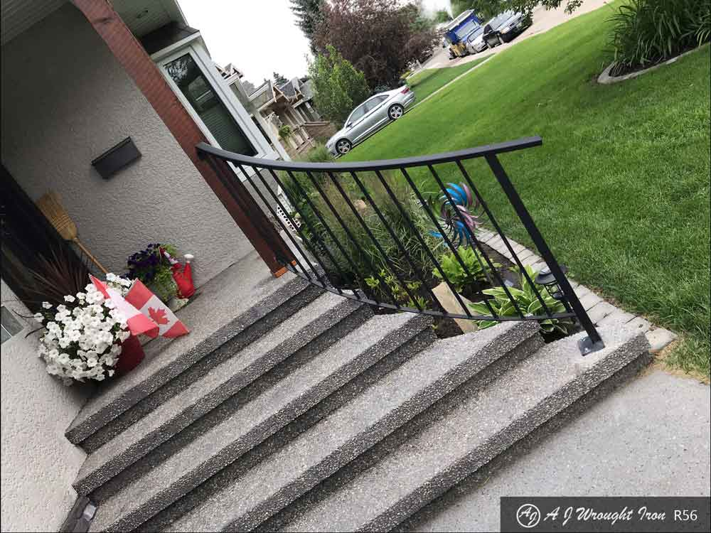 curved metal railing on concrete residential front step