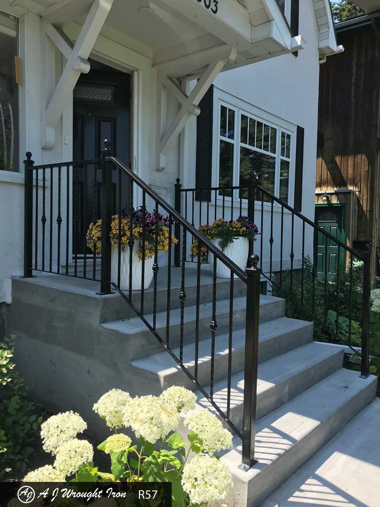 metal step railing on traditional white house